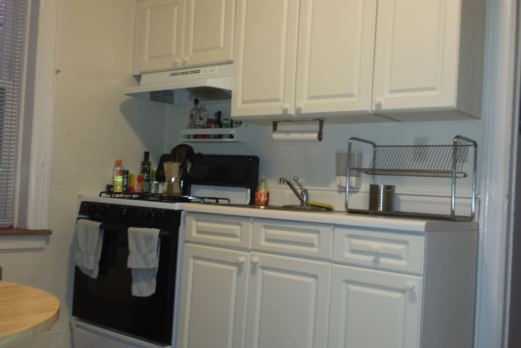 Kitchen is very spacious and clean.
