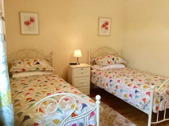 The 2nd bedroom is a twin-room en-suite with comfortable single beds tastefully dressed with hotel quality bed linen.  The en-suite has a walk-in assisted shower area, no steps, locker and bedside light with clock radio and black out window blinds
