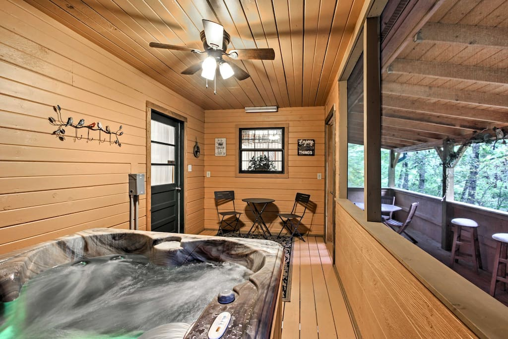 This charming cabin is nestled in a quiet, woody hillside, offering comfortable accommodations for 4 guests plus a private hot tub!