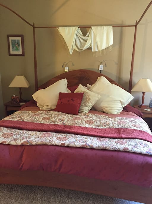The master bedroom. Sweet dreams on this cherry-wood king size bed with carved headboard.