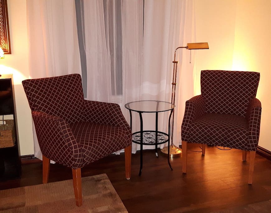 Hotel-quality chairs, space to relax by the fire.
