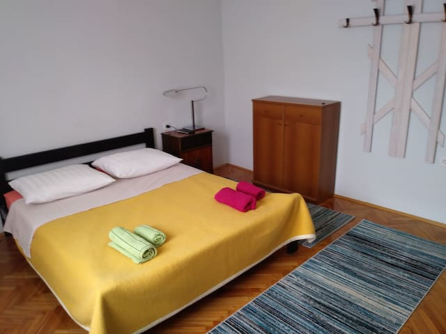 Room 1 with double bed,cable network TV and ceiling fan above the bed