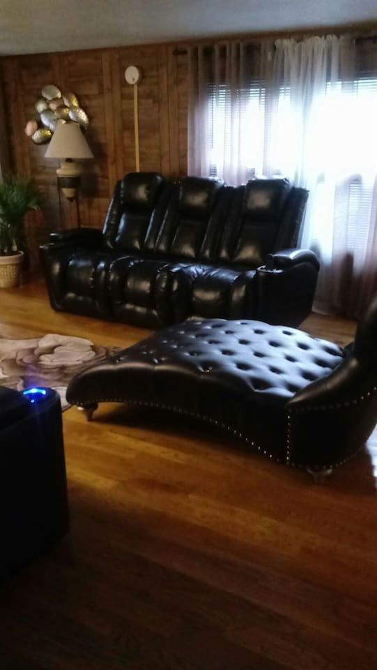Bring your group with you . Enjoy the comfortable living room with two recliners , a stationary sofa and a lounge chair. While watching a 50 inch  tv set.