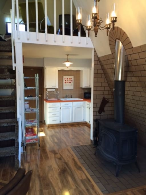 Open floor plan with wood stove.