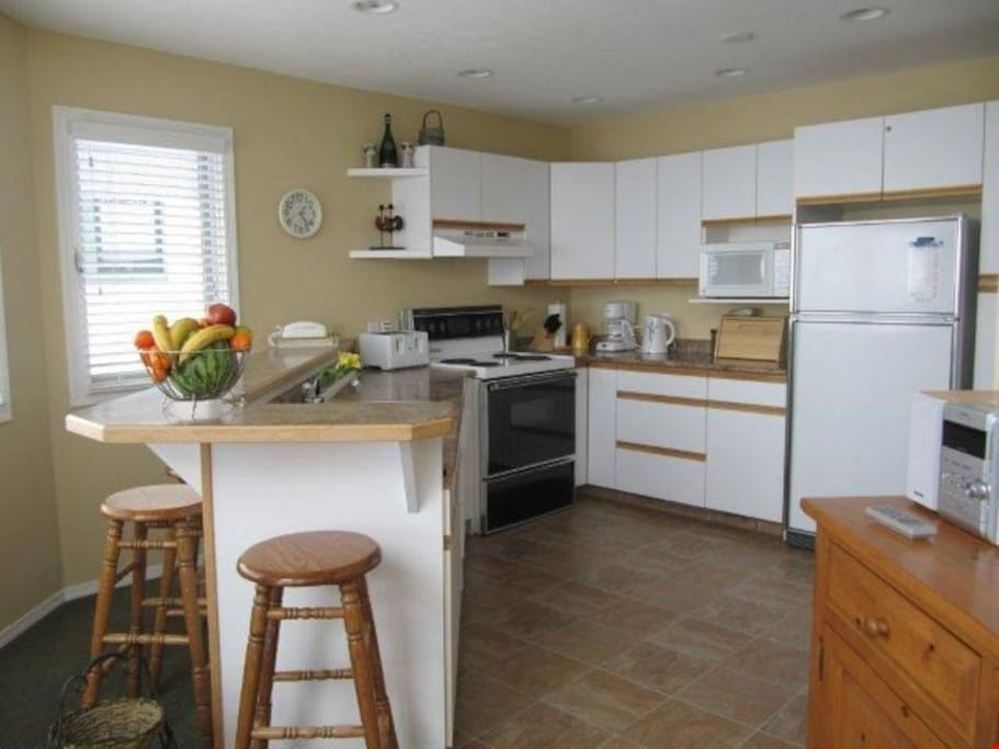 Prepare meals in the privacy of your own suite with the fully equipped kitchen, plus breakfast bar and stools.