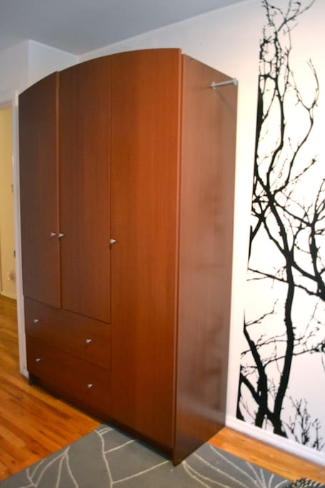 Private bedroom - Armoire with hangers and full length mirror