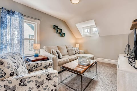 A beautiful living room with couches and a TV for your enjoyment.