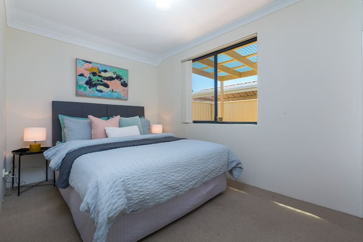 Bedroom 3 - queen bed & robe. Window looks out to the rear courtyard. Located to the rear of the property next to bedroom 2.