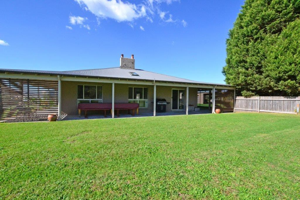 Renovated, spacious farmhouse with verandah all round, set on huge lawns.