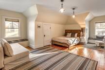 Huge upper level bedroom with queen bed and queen sofa bed