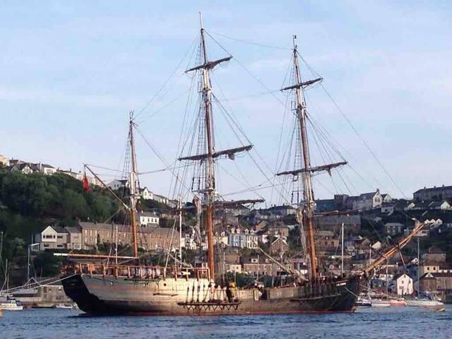Sleep on a historical tall ship + breakfast.
