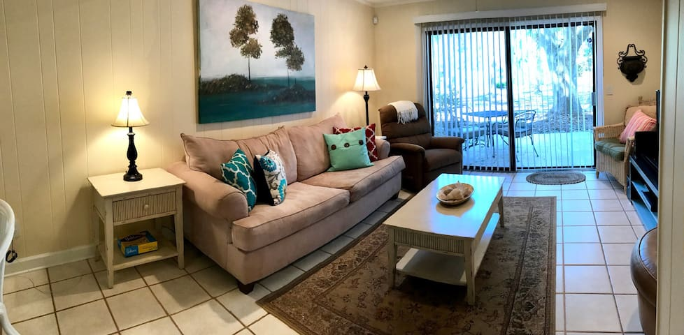 The living space was updated in May 2017 with fresh paint and a new sofa.