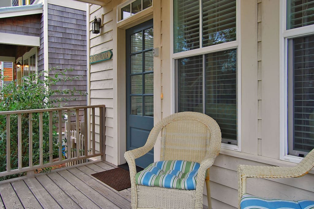 Outside chairs on the covered front porch to enjoy the beach breeze.
