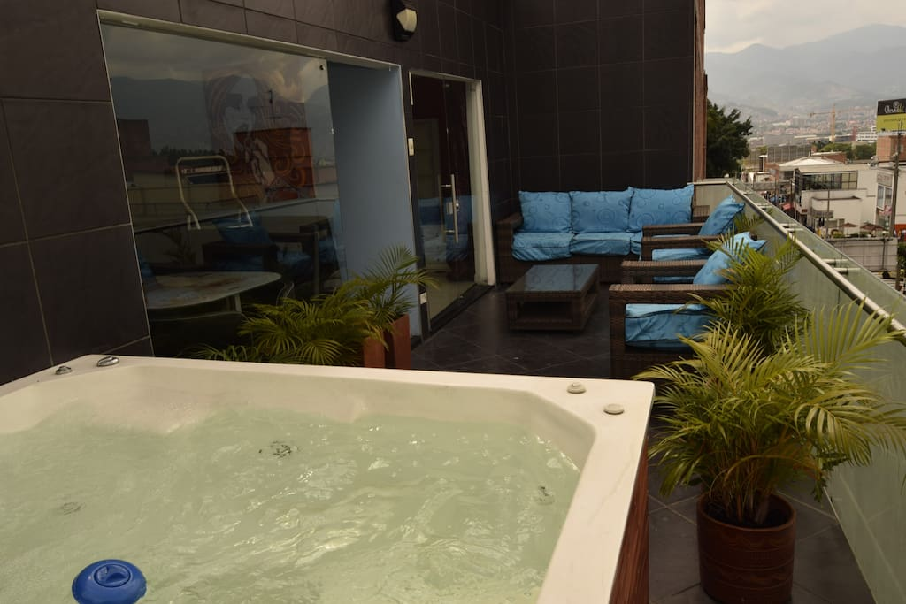 Awesome Balcony with Couches, 8 person Jacuzzi and Street view