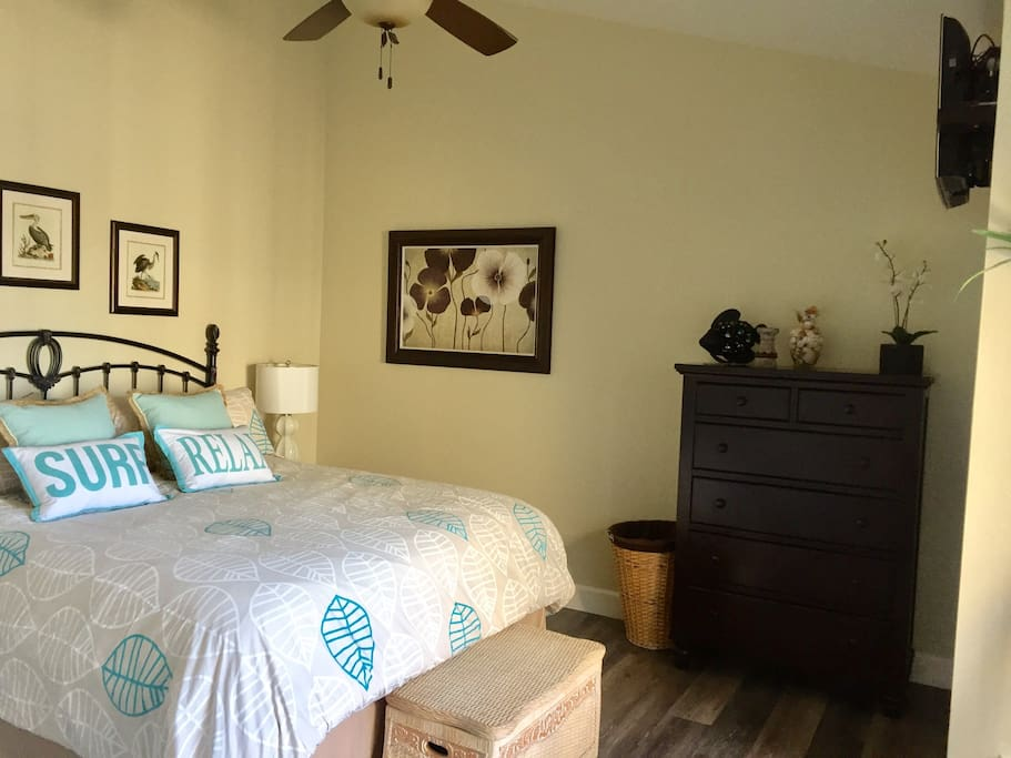 Master bedroom with Cal King bed and balcony with ocean views.