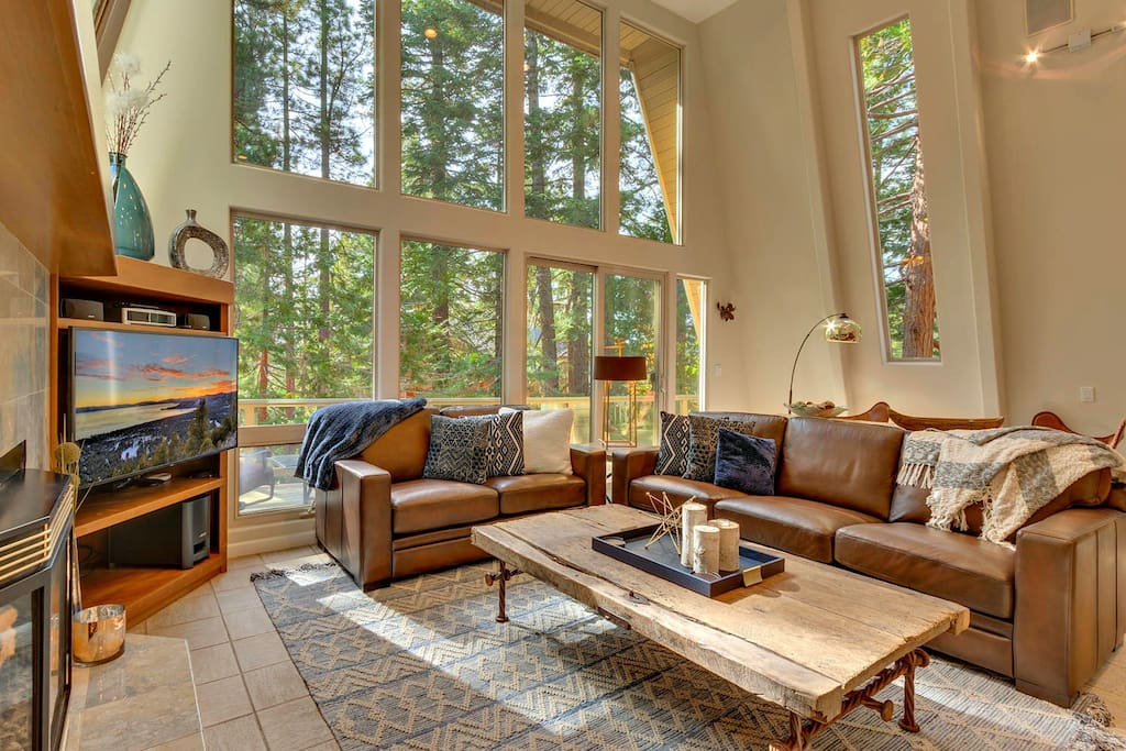 Comfortable seating with ample throw blankets, gas fireplace, and ample entertainment options.  20' floor to ceiling windows let the outdoors in.