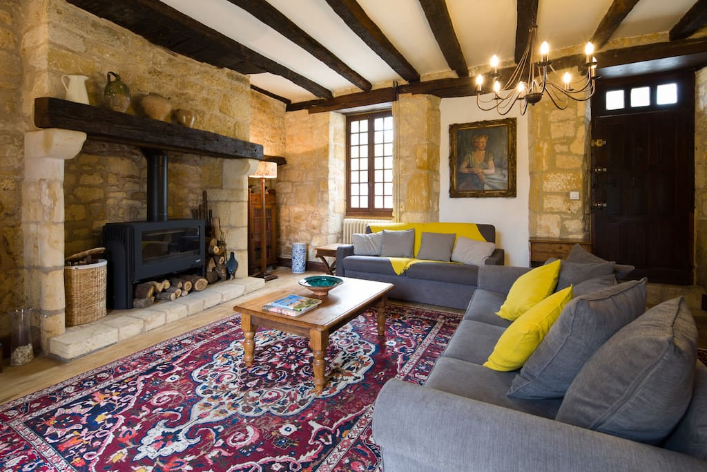 Comfortable sitting room with log burner and satellite TV (UK, French and most European channels).