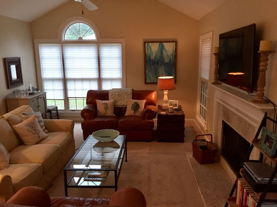 Large living room with lots of natural light when blinds are open