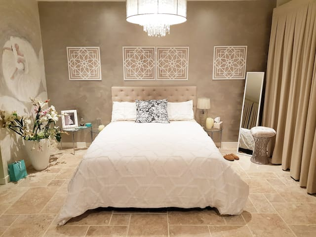Luxurious home with enourmous bedroom.
