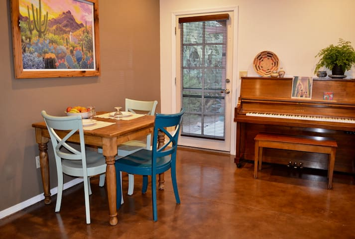The dining table seats four. And there's an upright piano for those who like to tickle the ivories.