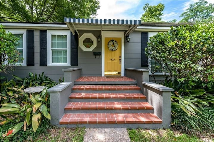 The front of the house is very unique yet welcoming. A quirky approach that echos from home to home throughout the neighborhoods within this part of Shreveport. Follow the drive way on the right side of the house to access the gate entrance.