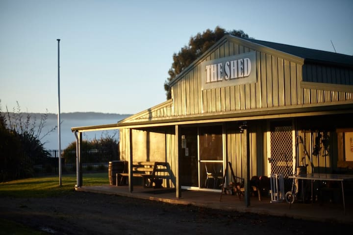 The Shed sleeps 28.  Large common room, dining facilities, commercial kitchen, bar, wood fire, pool table, table tennis.  All under the same roof as bathrooms.