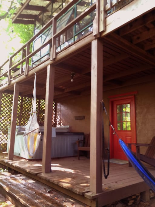 Closer view of entrance, hot tub, and deck.
