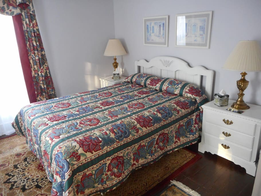 Ray's Room is upstairs. It has a Queen size bed, an antique chair and lamp for reading, a dresser, a large closet, and the large shared bath down the hall.