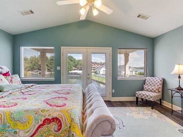 Master bedroom-upstairs w/ doors opening to balcony