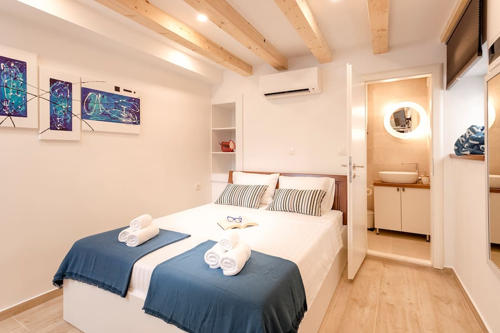 Double bed with the connected bathroom. The room has A/C and satellite smart TV