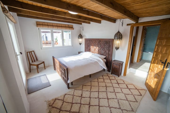 Bedroom three in guest house with kingsize bed and en suite bathroom