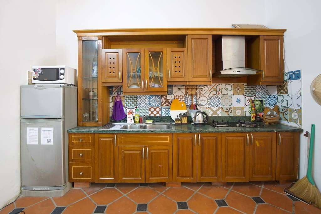 Kitchen with fully cooking utensils