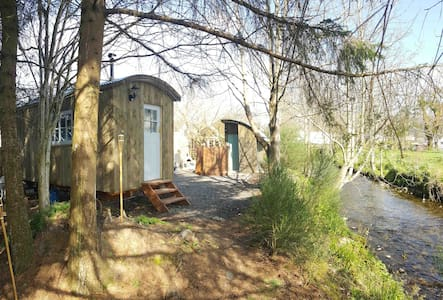 Idyllic riverside shepherds hut