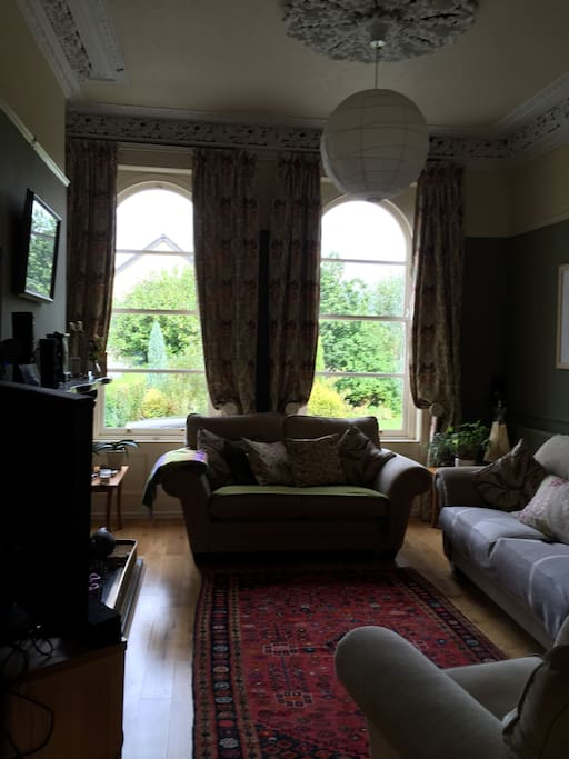 Spacious living room with original Victorian features. Private front garden.