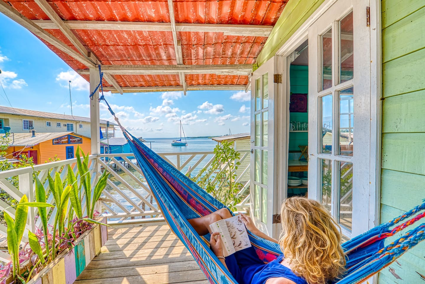 Artsy Caribbean wooden house on stilts over the water. Has everything  you need: close to town center,taxis, shuttles,laundry,groceries,beaches,local restaurants and is the place where the sunsets fall amazingly. This is an lgbt friendly home.