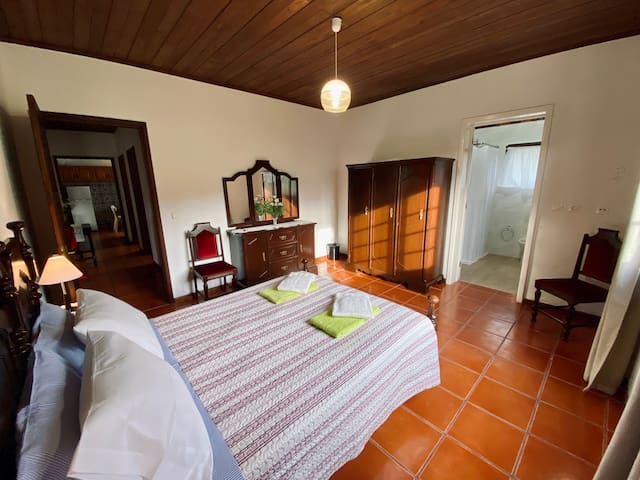 Master bedroom in main house with double bed (complimentary bath & pool/beach towels)