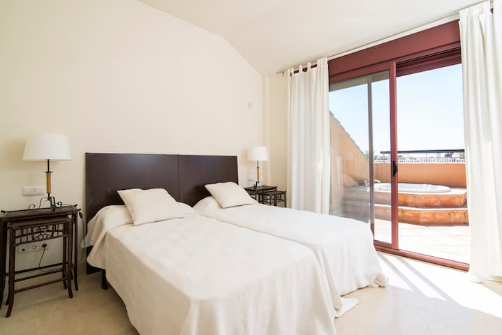 Guest room 2 with ensuite bathroom and stunning views. 2 twin beds 90 x 200cm.