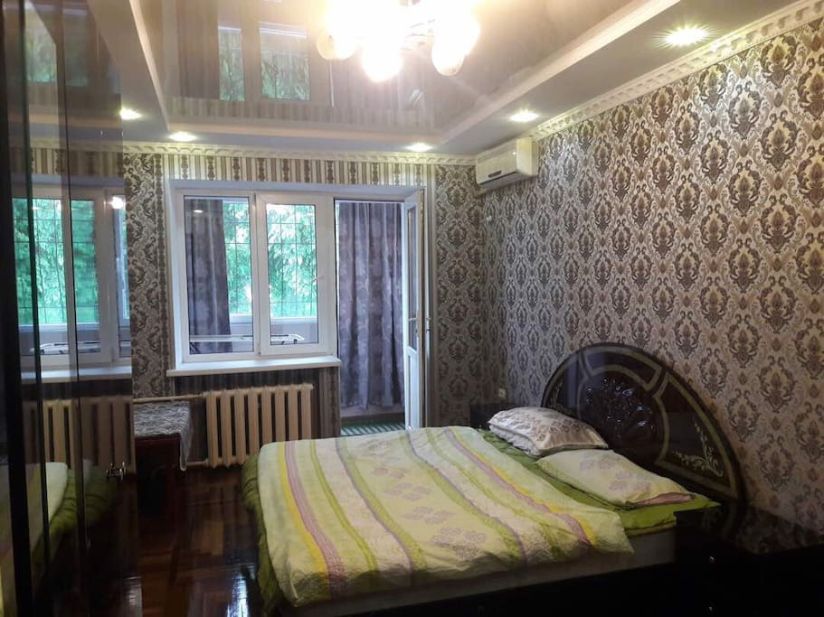 Balcony from bedroom with big windows and beautiful view on Manas'a avenue