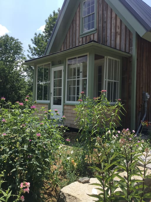 Little house... sun porch and pocket garden in July