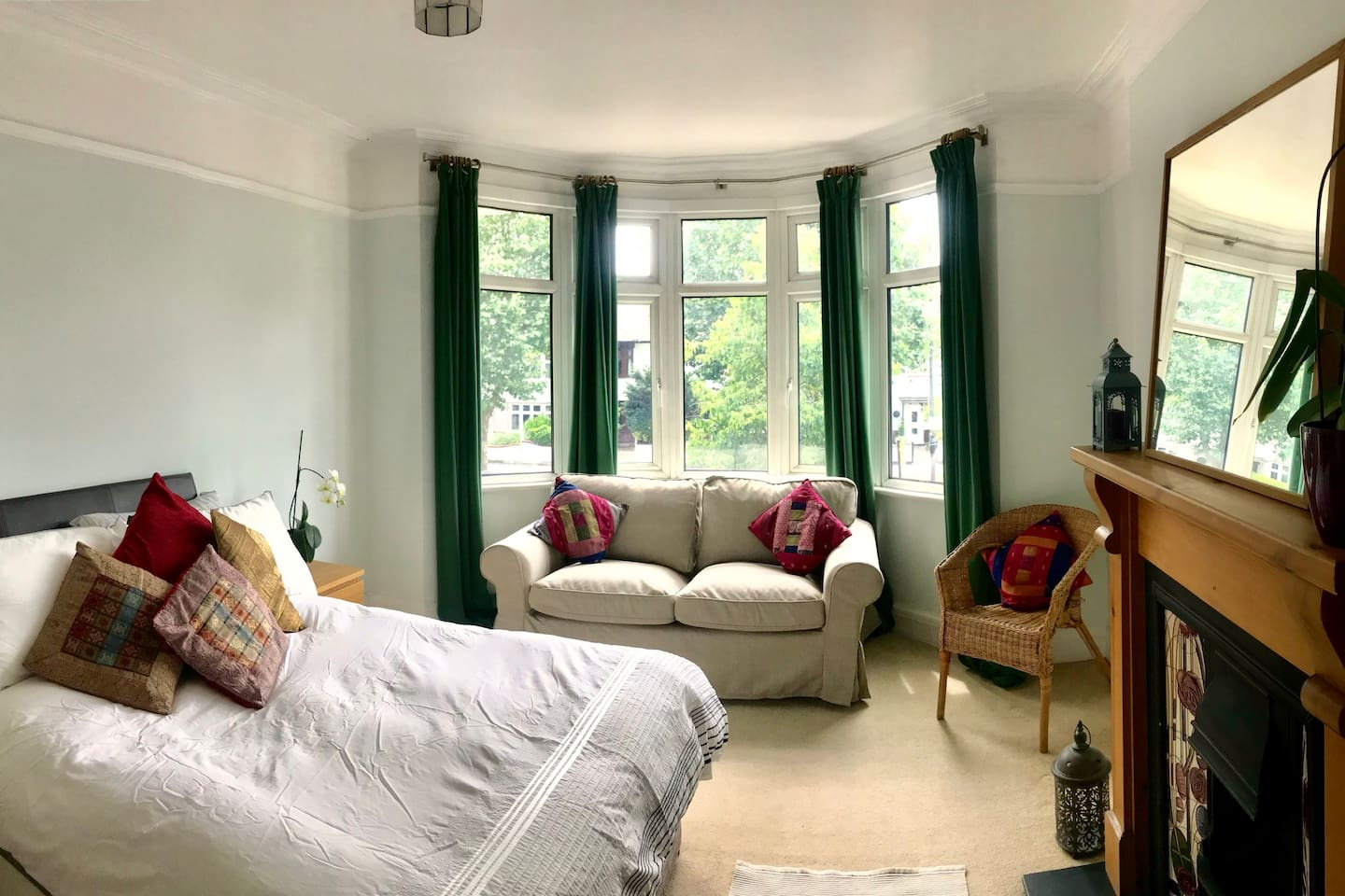 Spacious, light double bedroom with bay window and fireplace