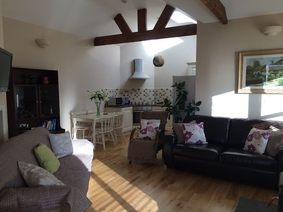 cosy sitting room with stove and also pull out sofa bed as well as double bedroom