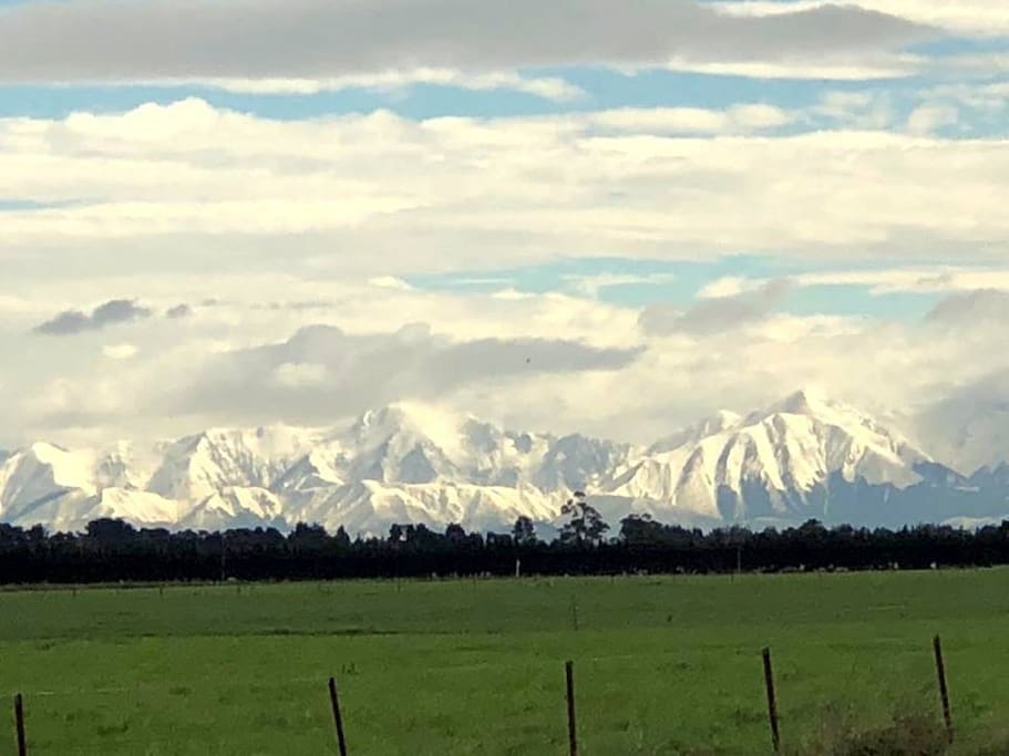 A view of the Southern Alps in winter from the driveway