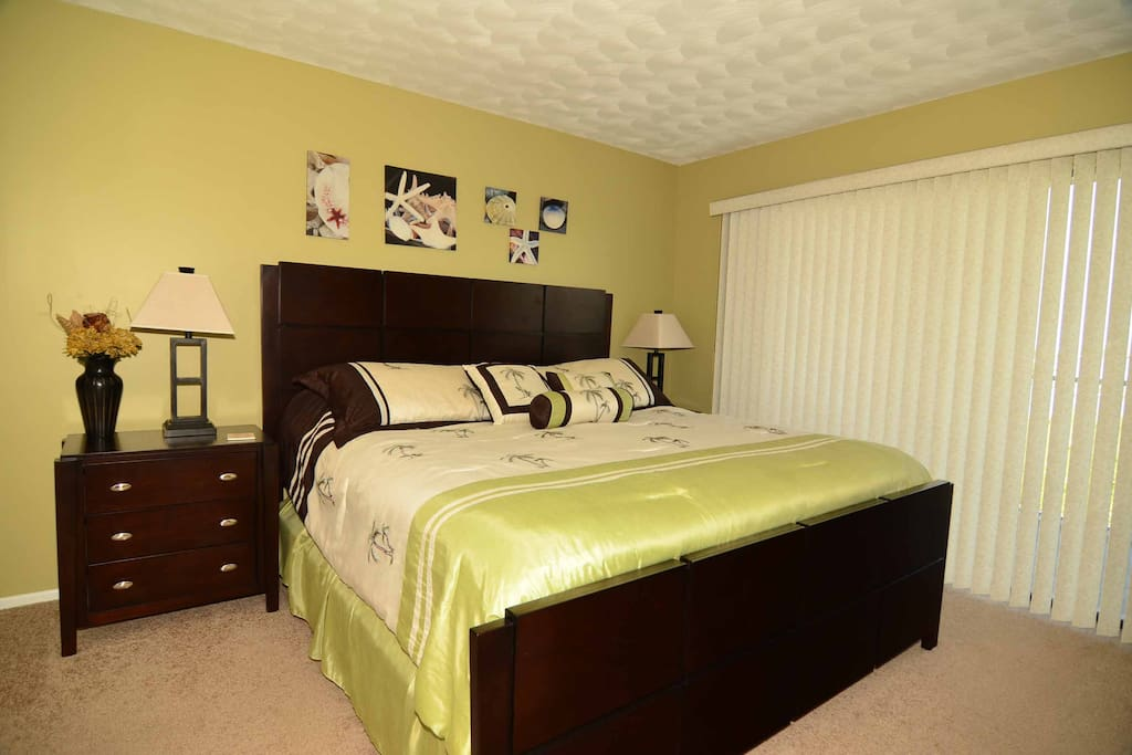 King size bed with flat screen tv, walk in closet and balcony