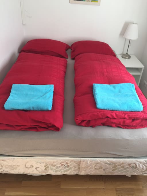 small room with queen bed