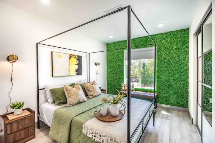Sleep tight in our wonderful bedroom featuring a grass wall!