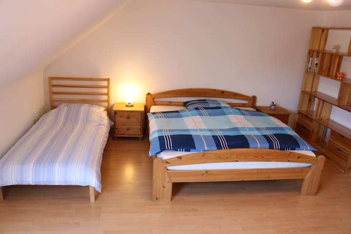 Guestroom with two beds, big double and single bed