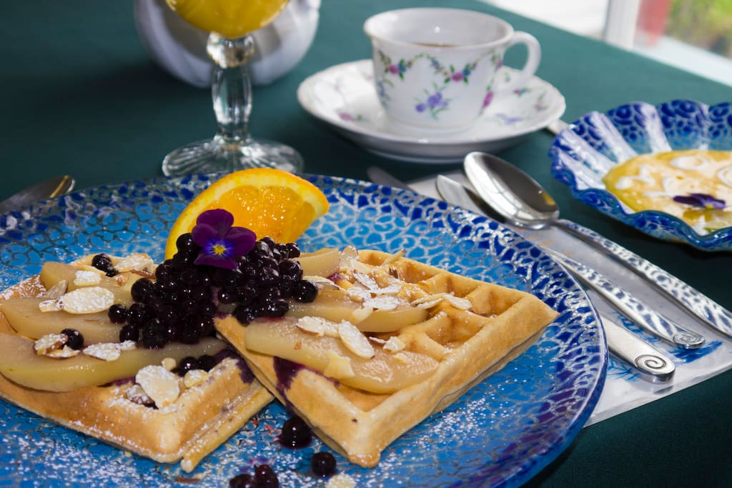 Waffles with gingered pears toasted almond wild organic blueberry compote served with organic Maine maple syrup.  Chilled mango and lime soup juice and coffee all part of your breakfast at Acadia's Oceanside Meadows Inn.