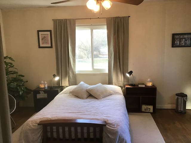 A large, airy room with full size futon bed with a new mattress. It has a small refrigerator and no AC as of yet.