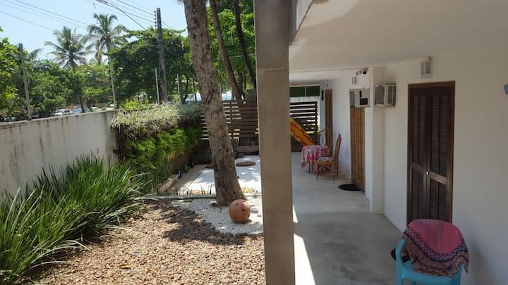 Suíte independente - praia e descanso no Guarujá