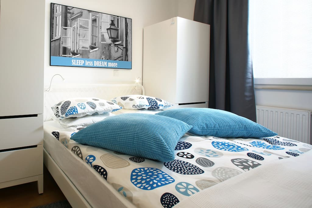 Comfy king size bed with high quality mattress for your sweet dreams. Blackout curtains will let you sleep in without waking up by daylight.